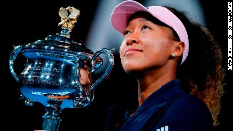 Japan's Naomi Osaka celebrates with the championship trophy during the presentation ceremony after her victory against Czech Republic's Petra Kvitova in the women's singles final on day 13 of the Australian Open tennis tournament in Melbourne on January 26, 2019. (Photo by DAVID GRAY / AFP) / -- IMAGE RESTRICTED TO EDITORIAL USE - STRICTLY NO COMMERCIAL USE --        (Photo credit should read DAVID GRAY/AFP/Getty Images)
