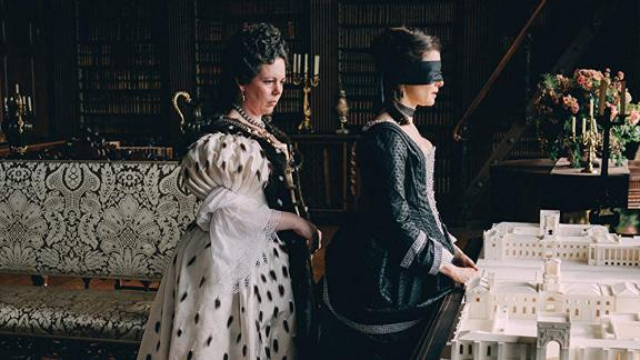 """Queen Anne (Olivia Colman) surprises Sarah Churchill (Rachel Weisz) with a model of Blenheim Palace in """"The Favourite."""""""