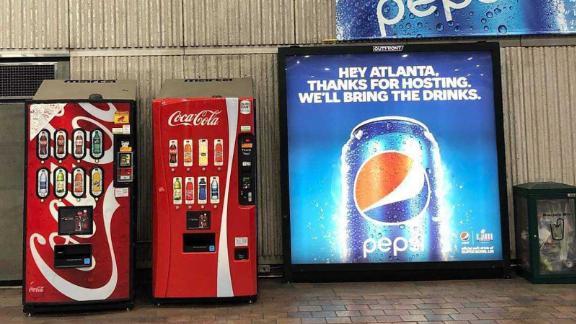 Pepsi Super Bowl ads surround Coca-Cola vending machines in Atlanta, GA.