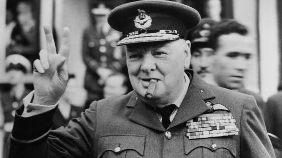Winston Churchill gives his famous v-sign in 1948.