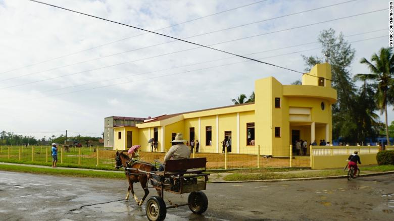 A horse and cart pass by the new church in Sandino, Cuba. The town in the early 1960's was notorious as a place where Cubans accused of helping anti-Castro rebels were sent to live in internal exile.