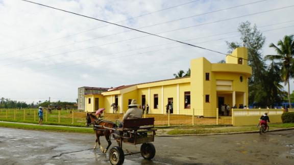 A horse and cart pass by the new church in Sandino, Cuba. The town in the early 1960