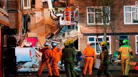 Authorities respond after a three-story home collapsed in The Hague on Sunday.