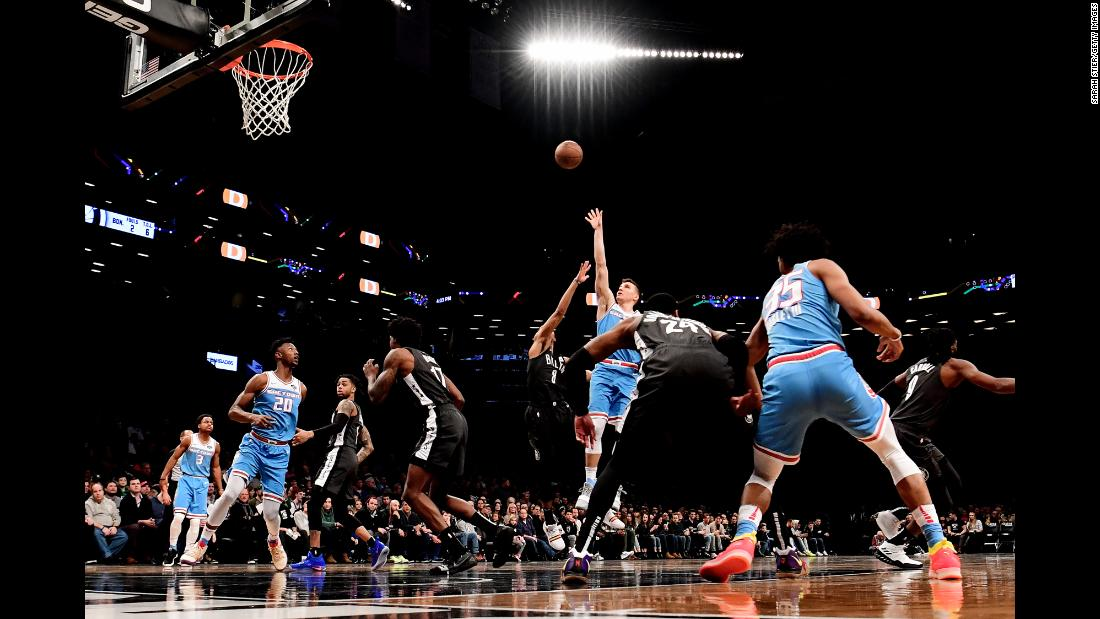 Sacramento's Bogdan Bogdanovic shoots a floater in the lane during an NBA game against Brooklyn on Monday, January 21.