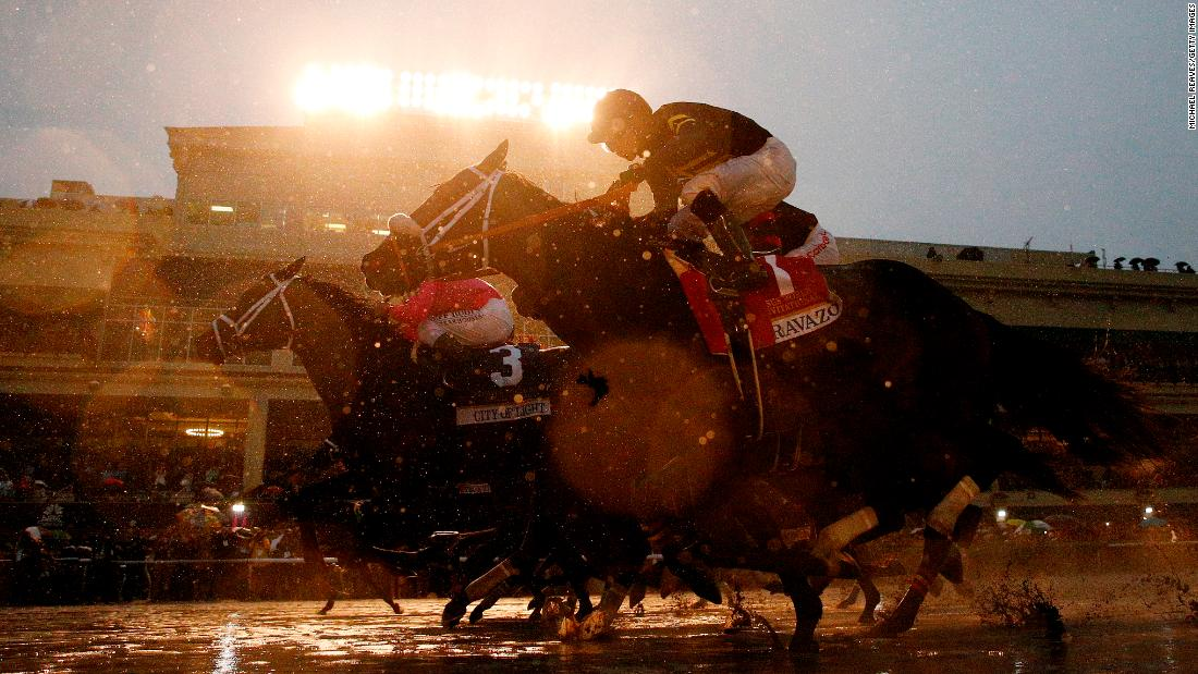 Horses break from the gate at the start of the Pegasus World Cup, which took place in Hallandale, Florida, on Saturday, January 26. City of Light won the race in what was the final start of his career.
