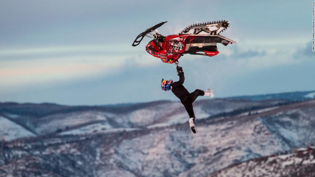 Daniel Bodin soars through the air on his way to winning the Snowmobile Freestyle event at the Winter X Games on Friday, January 25.
