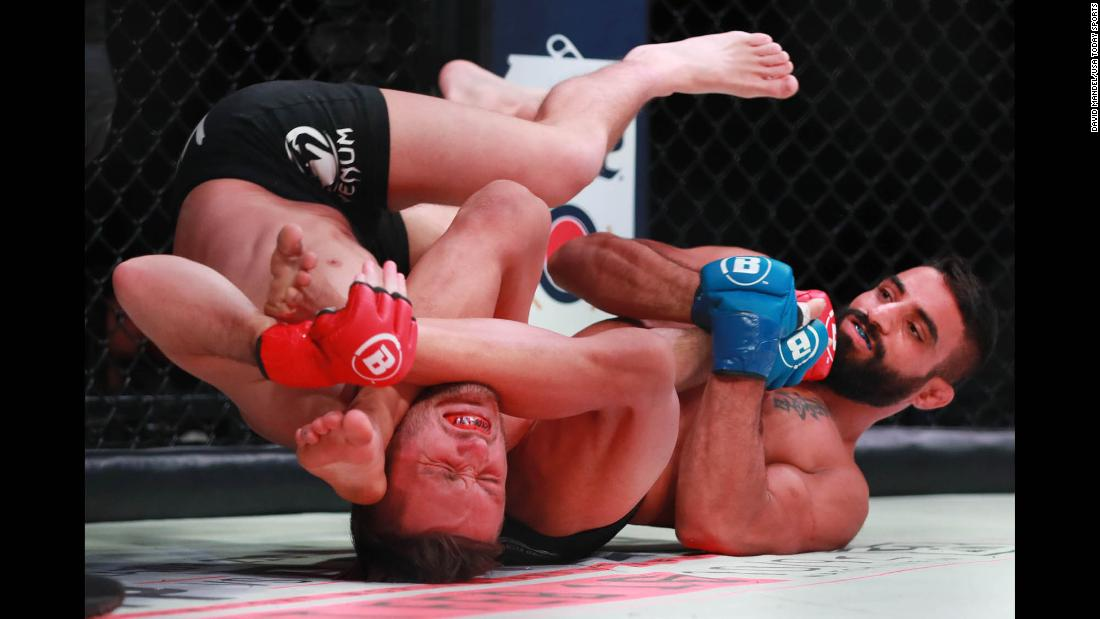 Adel Altamimi, right, wraps up Brandon McMahon during Bellator 214 on Saturday, January 26. Altamimi won his debut fight by first-round submission.