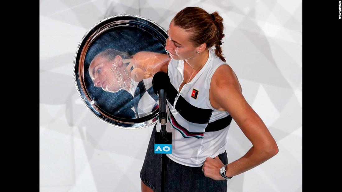 Petra Kvitova is reflected in her runner-up trophy as she's interviewed at the Australian Open on Saturday, January 26.