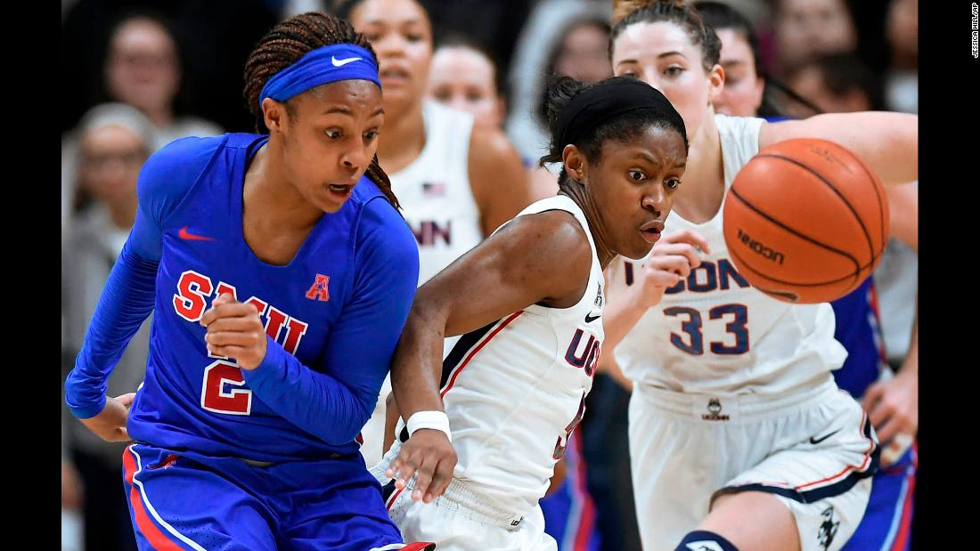 UConn's Crystal Dangerfield, right, steals the ball from SMU's Ariana Whitfield during a college basketball game in Storrs, Connecticut, on Wednesday, January 23.