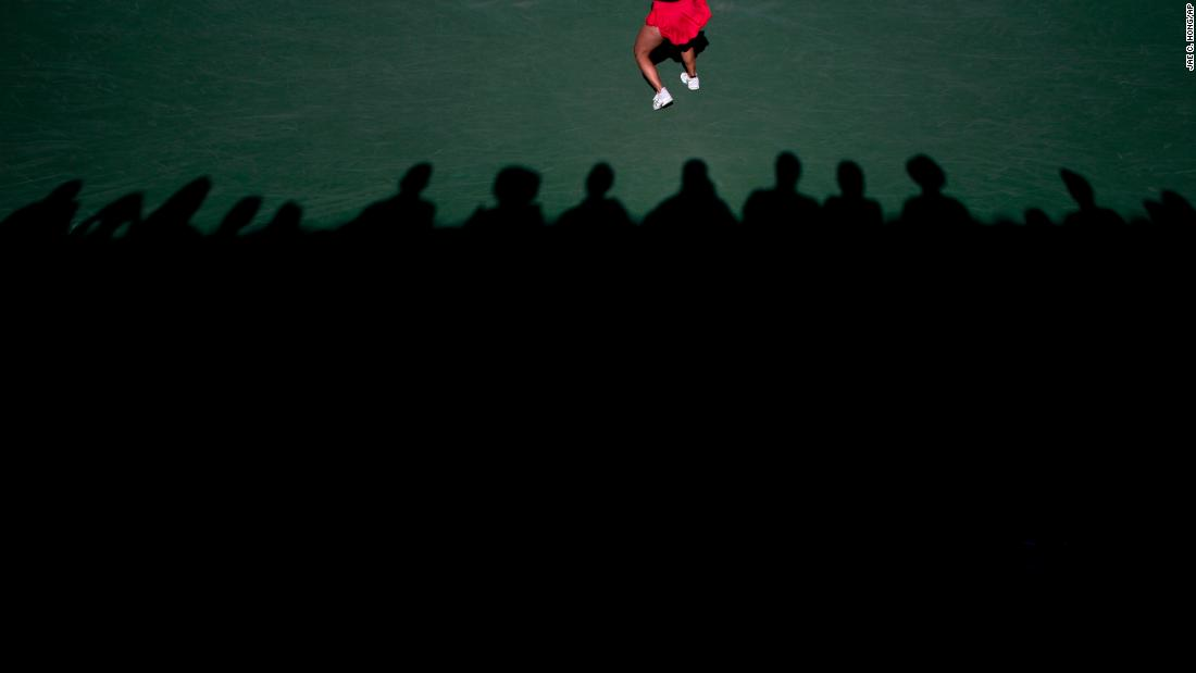 People watch Lauren Davis, a tennis player in the WTA Challenger Series, return a shot during a match in Newport Beach, California, on Friday, January 25.