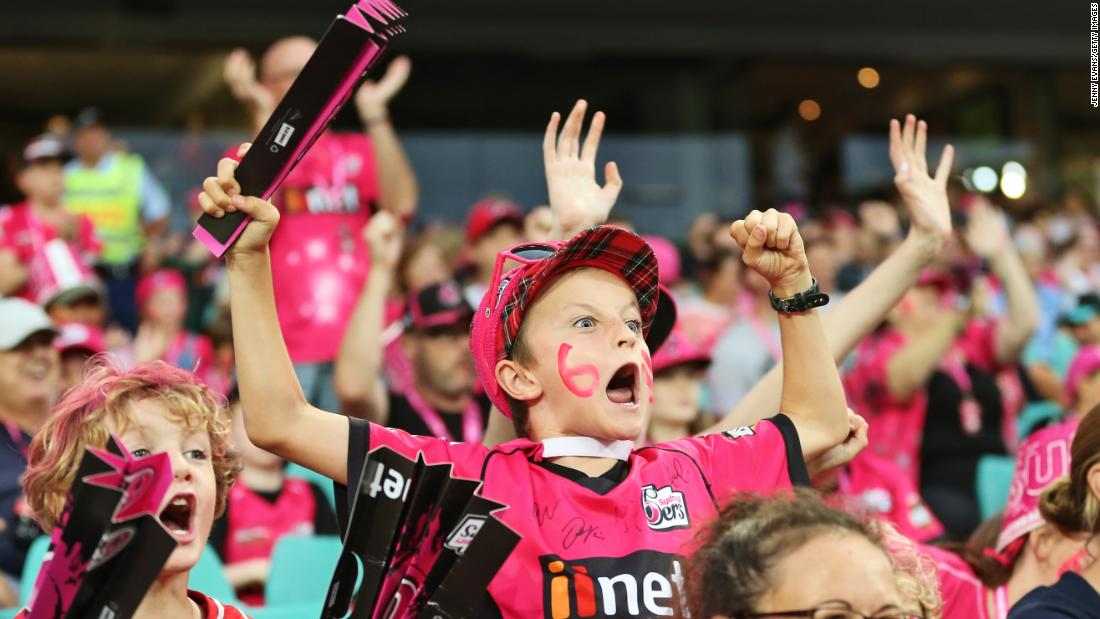 A young fan of the Sydney Sixers cheers on his cricket team during a match on Wednesday, January 23.