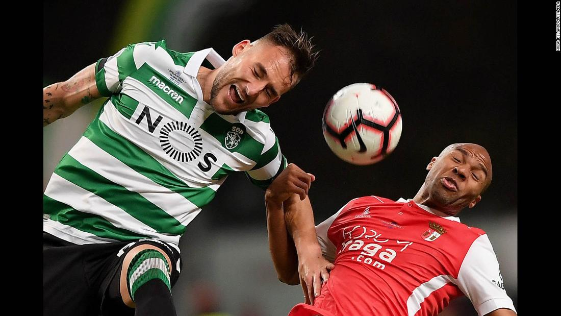 Sporting's Nemanja Gudelj, left, and SC Braga's Wilson Eduardo compete for a header during a League Cup semifinal in Braga, Portugal, on Wednesday, January 23. Sporting advanced to the final on penalties.