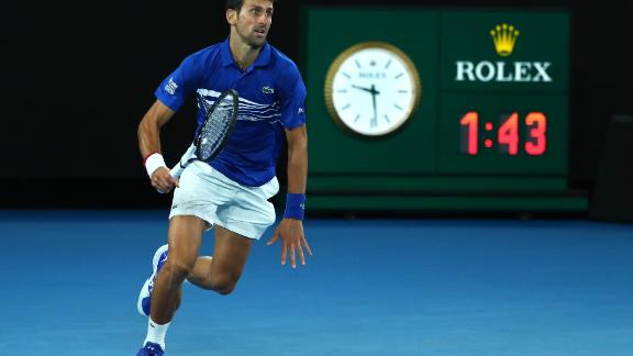 Novak Djokovic chases a ball against Rafael Nadal in Melbourne.