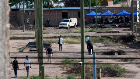 Police work on the property next to the house of Gilad Pereg, where the bodies of his mother and aunt were found on Saturday in Mendoza, Argentina.