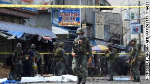 Philippines' Duterte visits church bombing town as ISIS threat reemerges