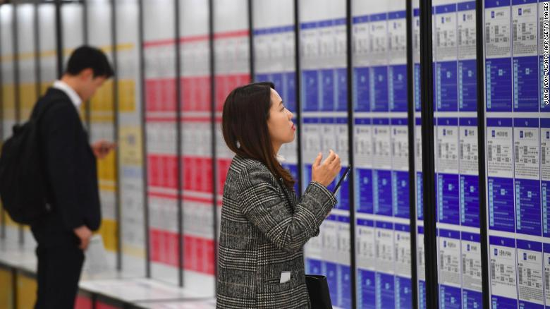 A woman looks at notices during a jobs fair in Seoul. Women often struggle to find a foothold in South Korea's male-dominated corporate culture and a series of firms have been caught using sexist recruitment targets to keep it that way.