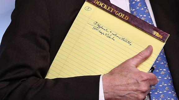 WASHINGTON, DC - JANUARY 28: With handwritten notes on a legal pad, National Security Advisor John Bolton listens to questions from reporters during a press briefing at the White House January 28, 2019 in Washington, DC. During the briefing, economic sanctions against Venezuela