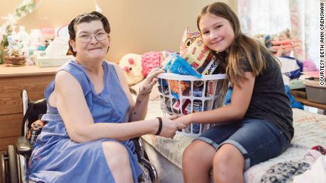 "Ruby Kate Chitsey delivers a nursing home resident some of the items requested through ""Three Wishes."""