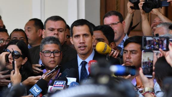 "Venezuela's National Assembly head and self-proclaimed ""acting president"" Juan Guaido, talks to journalists upon arrival at the National Assembly in Caracas on January 29, 2019. - Venezuela's Attorney General Tarek William Saab asked the Supreme Court on Tuesday to bar self-proclaimed acting president and opposition leader Juan Guaido from leaving the country and to freeze his assets. (Photo by Yuri CORTEZ / AFP)        (Photo credit should read YURI CORTEZ/AFP/Getty Images)"