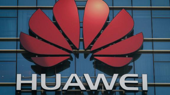 The Huawei logo stands on a Huawei office building in Dongguan in Chinas southern Guangdong province on December 18, 2018. (Photo by Nicolas ASFOURI / AFP)        (Photo credit should read NICOLAS ASFOURI/AFP/Getty Images)