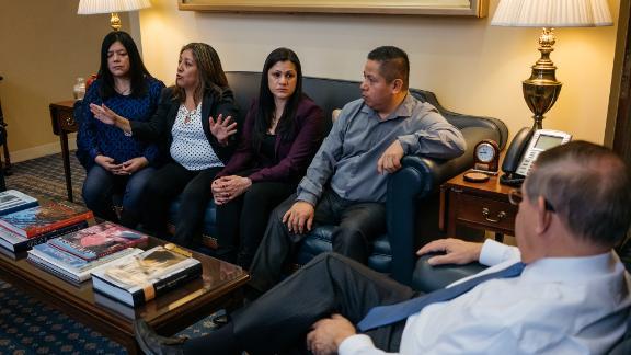 From left, Margarita Cruz, Victorina Morales, Sandra Diaz and Gabriel Sedano speak with Sen. Bob Menendez in his office in Washington.