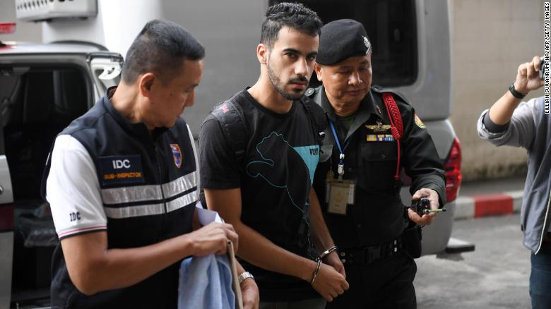Hakeem Al-araibi is escorted by immigration police to a court in Bangkok on December 11, 2018.