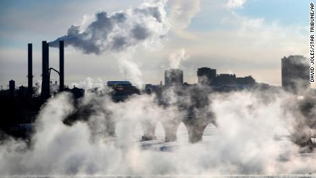 Water vapor rises above St. Anthony Falls on the Mississippi River near Minneapolis, Minnesota.