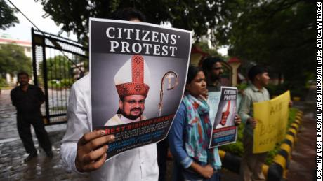 People hold a protest against Bishop Franco Mulakkal, after he was accused by a nun of raping her in the southern Indian state of Kerala.