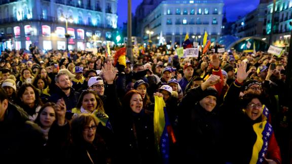FILE - In this Wednesday, Jan. 23, 2019 file photo, people gather during a protest against Venezuela's Nicolas Maduro and in support of an opposition leader self-proclaimed as the interim president of the country in Madrid, Spain. Venezuela has seen an enormous outflow of people in recent years as its economy and democratic institutions have crumbled. Now many of these Venezuelans living abroad are anxiously watching events unfold in Caracas and wondering if they may soon be able to go home. (AP Photo/Manu Fernandez, File)
