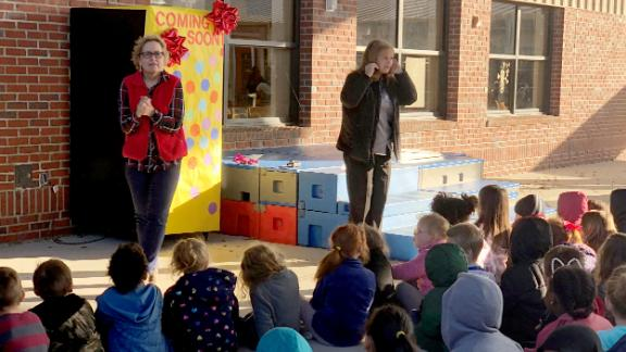 The school's principal and media specialist held a pep rally to unveil the new vending machine.
