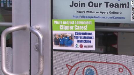 An anti-trafficking sticker is pictured on a door as part of the Convenience Stores Against Trafficking, a program of the nonprofit In Our Backyard.