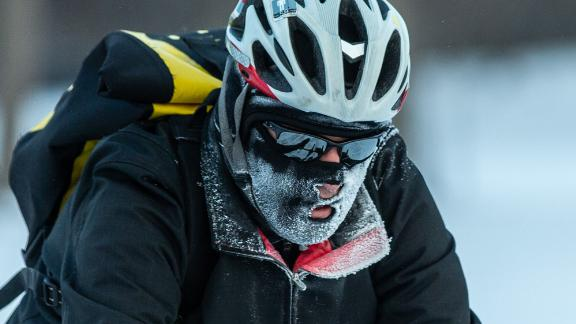 A bicyclist passes through heavy frost in Nokomis parkway, south west Minneapolis, as temperatures in the area dipped below freezing overnight in Minnesota on January 29, 2019. - The polar vortex is here -- tens of millions of people in the US braced on January 29, 2019, for a deep arctic chill, which authorities say could be life-threatening. Sub-zero temperatures already blanketing parts of Canada were already sweeping across the US Midwest and towards the East Coast. (Photo by Kerem Yucel / AFP)        (Photo credit should read KEREM YUCEL/AFP/Getty Images)