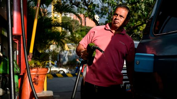 A man pumps fuel at a gas station in Caracas, on January 29, 2019. - The United States announced sanctions against Venezuela's state oil company Monday in a coordinated effort with the main opposition leader to cripple embattled President Nicolas Maduro's power base. (Photo by Luis ROBAYO / AFP)        (Photo credit should read LUIS ROBAYO/AFP/Getty Images)