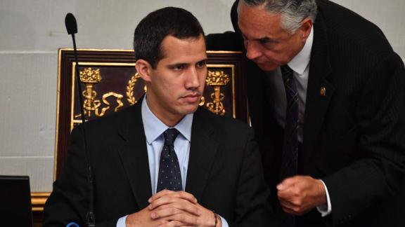Guaido listens to deputy Rafael Veloz during a session at the National Assembly in Caracas on January 29. The Assembly met to debate a legal framework for creating a transitional government and calling new elections. Simultaneously, Venezuela