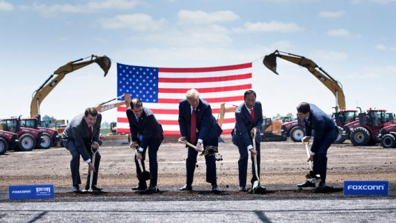 TOPSHOT - Wisconsin Governor Scott Walker (2nd L), US President Donald Trump (C), Foxconn Chairman Terry Gou (2nd R), Speaker of the House Paul Ryan (R) and an unidetified official (L) participate in a groundbreaking for a Foxconn facility at the Wisconsin Valley Science and Technology Park on June 28, 2018 in Mount Pleasant, Wisconsin. (Photo by Brendan Smialowski / AFP)        (Photo credit should read BRENDAN SMIALOWSKI/AFP/Getty Images)