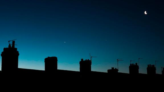 From left to right: Venus, Jupiter and the Moon line up in the pre-dawn sky in Newcastle, England