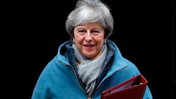 (FILES) In this file photo taken on January 21, 2019 British Prime Minister Theresa May leaves 1o Downing Street to make a statement to the House of Commons in London on, on changes to her Brexit withdrawal agreement.