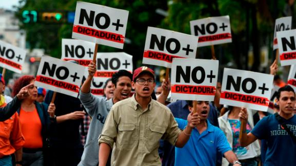 Opposition demonstrators protest against Maduro
