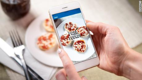 The new promotion lets customers earn a free Domino's pie when they eat pizza — even if they buy it from a competitor.