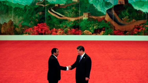 BEIJING, CHINA - SEPTEMBER 03: Cameroon President Paul Biya, left, shakes hands with Chinese President Xi Jinping during the Forum on China-Africa Cooperation held at the Great Hall of the People on September 3, 2018 in Beijing, China. (Photo by Andy Wong - Pool/Getty Images)
