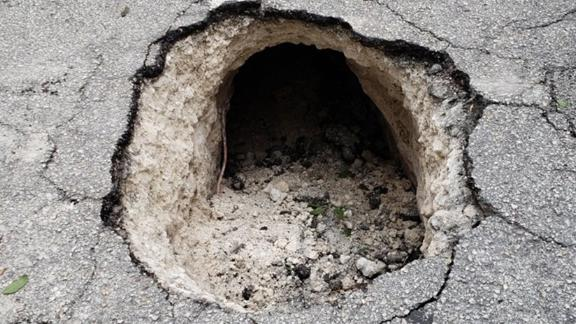Public works employees at first thought they had been called to a sinkhole.