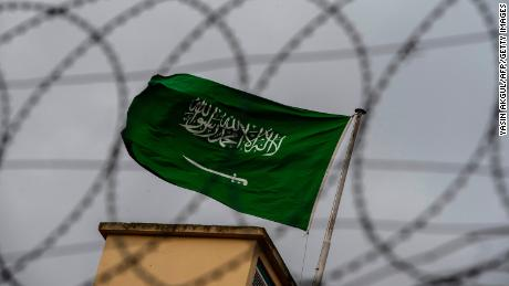 A Saudi Arabia flag flies behind barbed wires at the Saudi Arabian consulate in Istanbul.