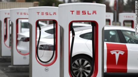 Tesla cars recharging at a facility in Petaluma, California. The company rattled investors on Wednesday by reporting profit that fell short of expectations.