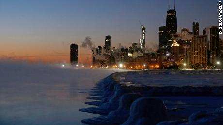 Ice lines the shore of Lake Michigan before sunrise on Thursday in Chicago.