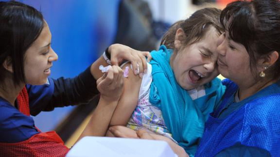 A student at Carlin Springs Elementary School in Virginia receives an H1N1 flu vaccination.