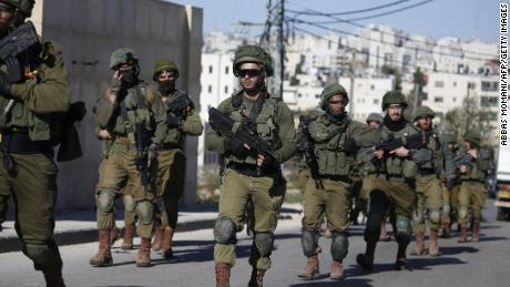 Israeli troops withdraw from Ramallah in the West Bank on December 15 after blowing up a house belonging to a Palestinian accused of killing an Israeli soldier.