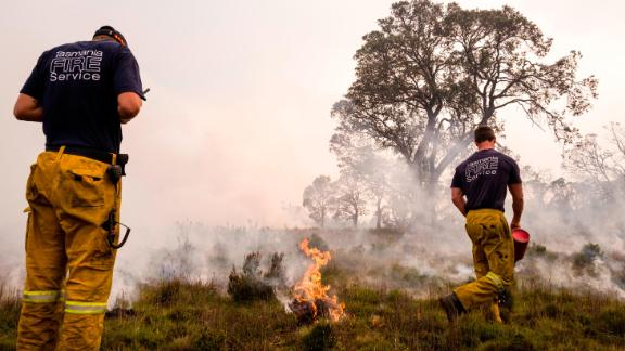 The Tasmania Fire Service battles blazes across the state on January 23.