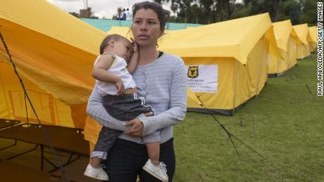 "Venezuelan migrants at the humanitarian camp in Bogota on November 13, 2018. - Venezuelans migrants are transferred voluntarily to a humanitarian provisional shelter by Bogota's Town Hall, the first city to announce an ""Integral Plan of Attention for Venezuelans"", to offer social and humanitarian services. As reported by the United Nations Organization for Migration (IOM) and the United Nations High Commissioner for Refugees (UNHCR), refugees and migrants from Venezuela around the world have reached three million. (Photo by Raul ARBOLEDA / AFP)RAUL ARBOLEDA/AFP/Getty Images"