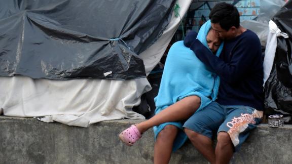 Venezuelan migrants remain at an improvised camp near a bus terminal in Bogota on November 13, 2018.