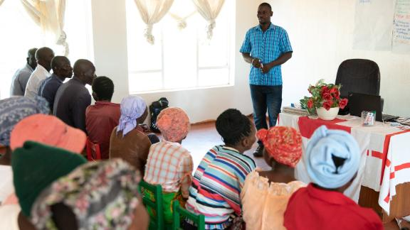 Jemitias Denhere, Agriculture Officer, teaches a class of farmers from across Mwenezi at the Red Cross farming school.